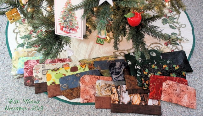 Handmade zippered bags of various fabrics under the Christmas tree.