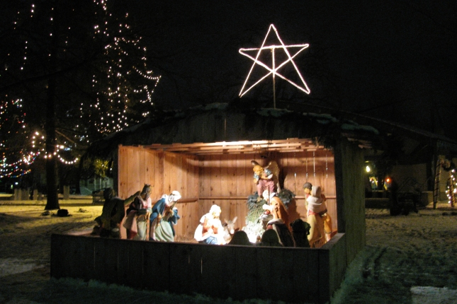 The Manger with the Nativity Story in Bronson Park, Kalamazoo - at night.