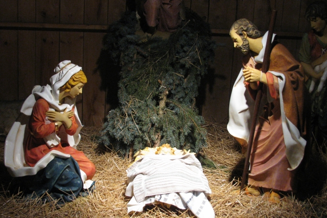 A close-up of the Christ Child in the Nativity at Bronson Park in Kalamazoo - Jesus, Mary, and Joseph.
