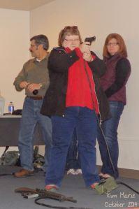 Kim shooting a gun using air during scenarios at Alpena Combat Readiness Training Center