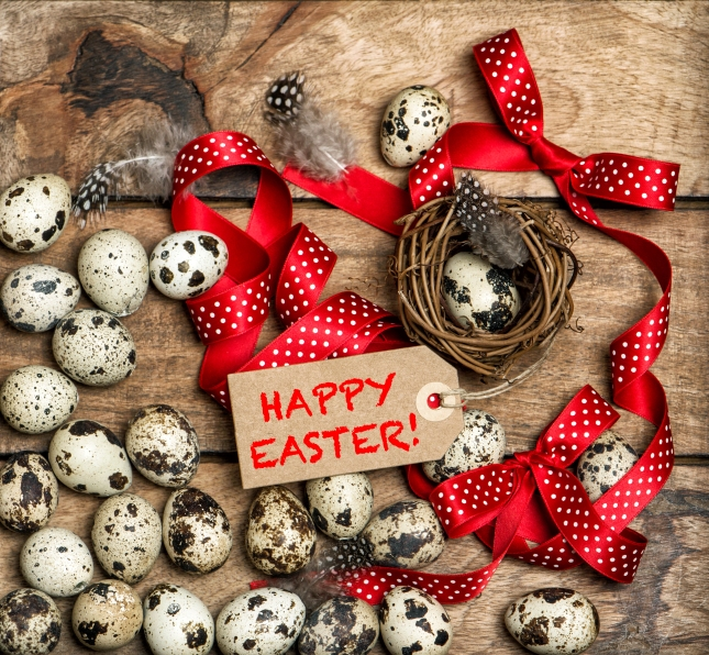 bigstock-Easter-Eggs-With-Red-Ribbon-Bo-121438676.jpg