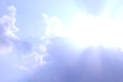 Clouds in the sky with the sun shining bright